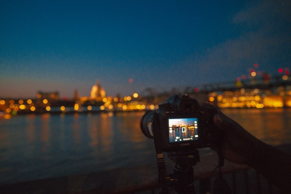 camera capturing lighted cityscape