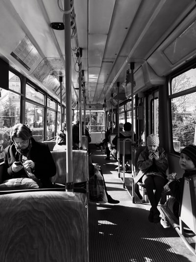 grayscale photo of person inside bus