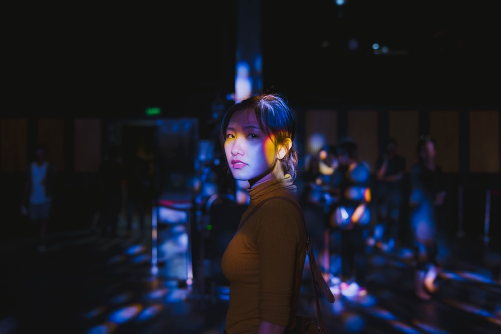 selective focus photo of woman standing