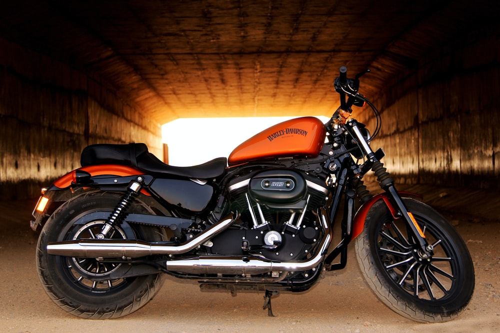orange and black bobble motorcycle in tunnel