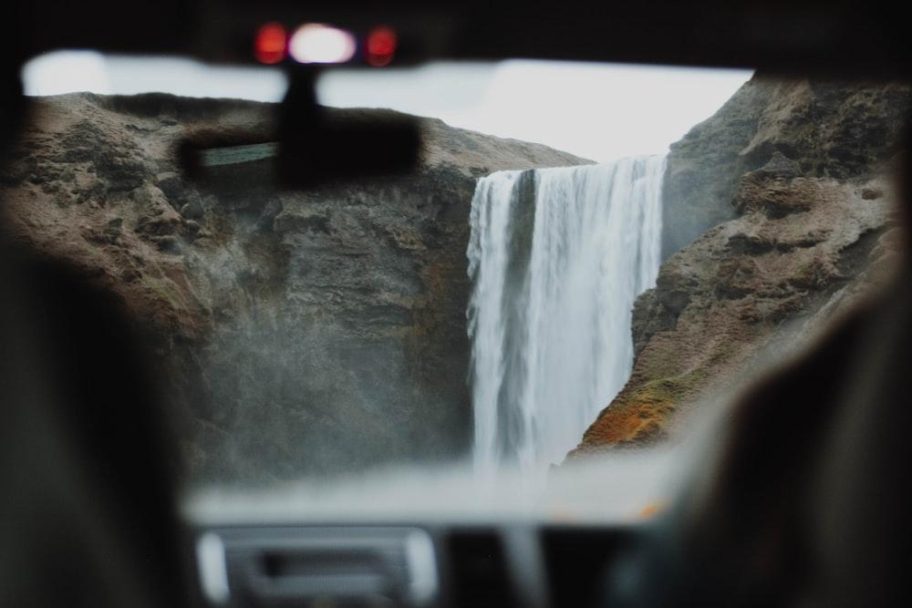 vehicle view of waterfalls during daytime