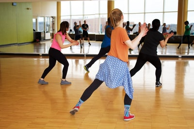 women dancing near mirror dance zoom background