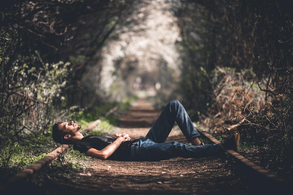 man lying on railway