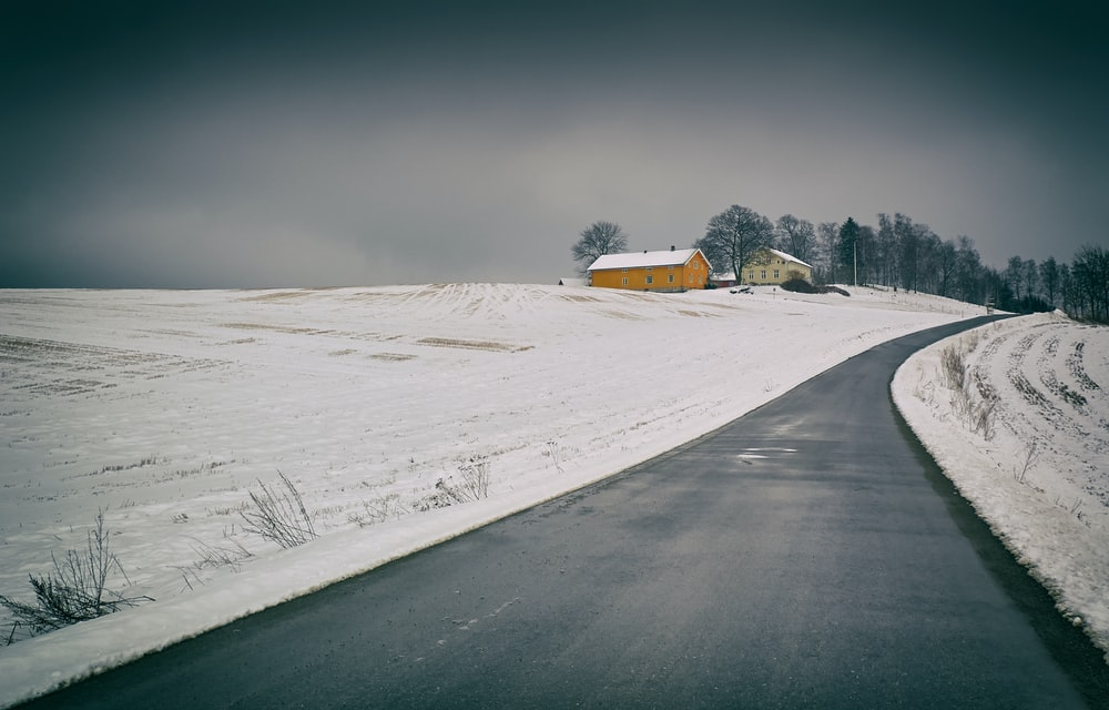 road surrounded by snow
