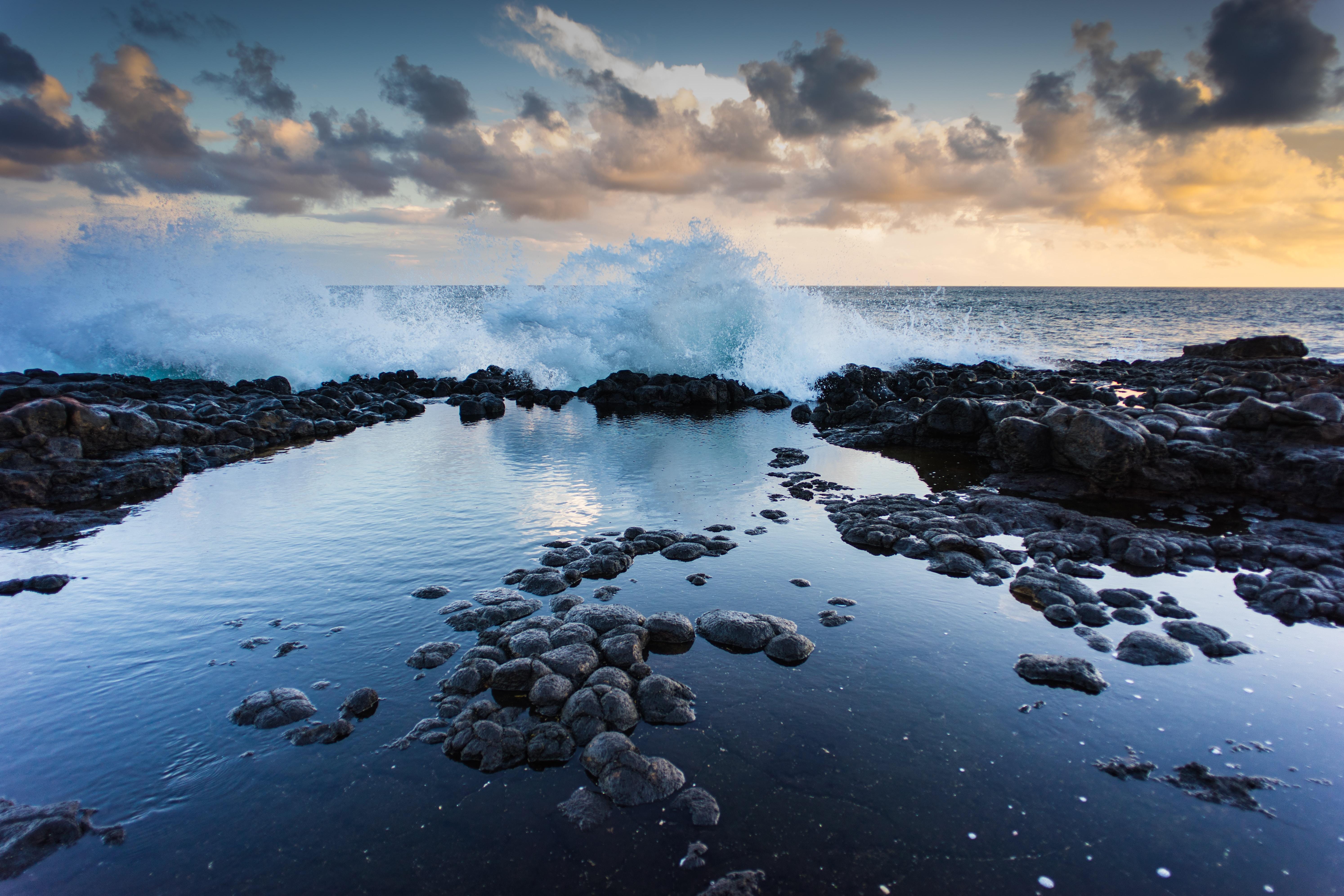 landscape photography of rocks and barrel wave