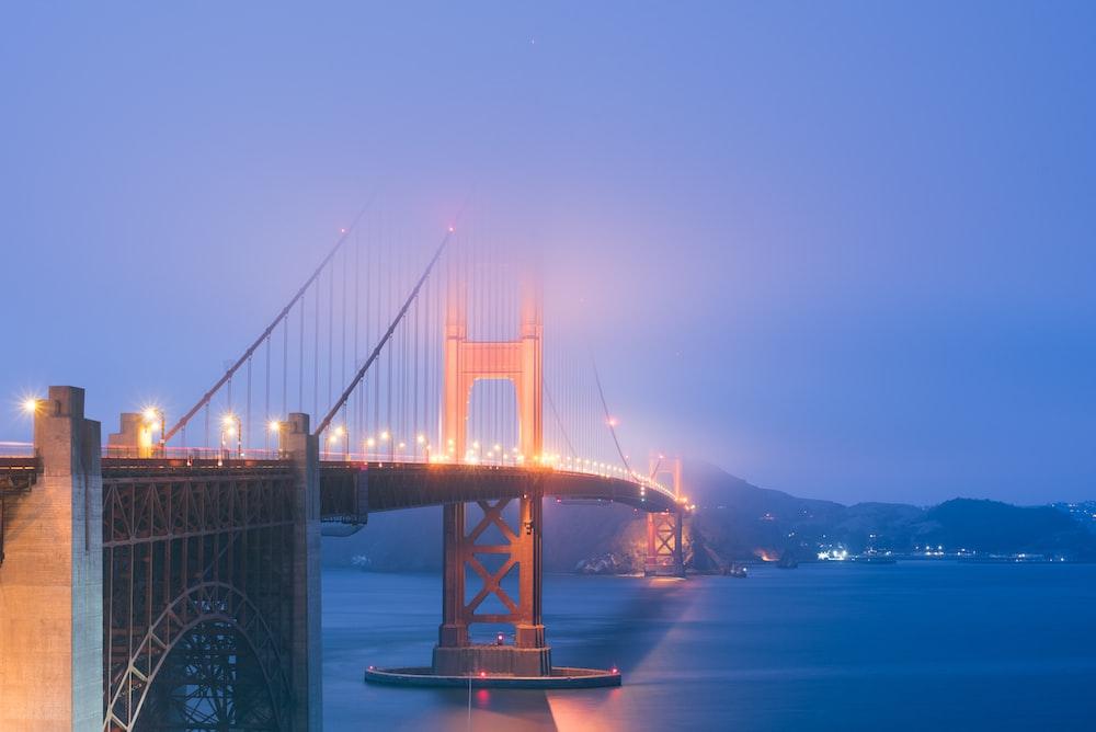 gray suspension bridge near body of water