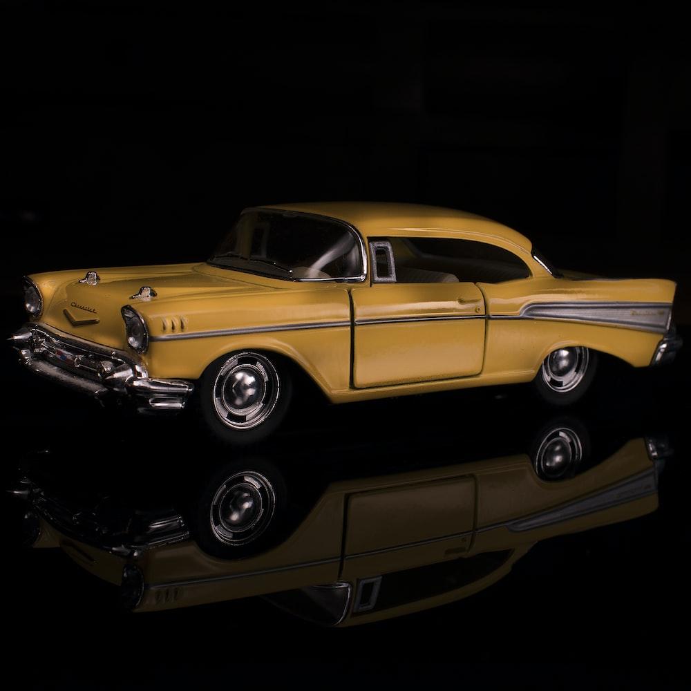 yellow Chevrolet Corvette classic coupe