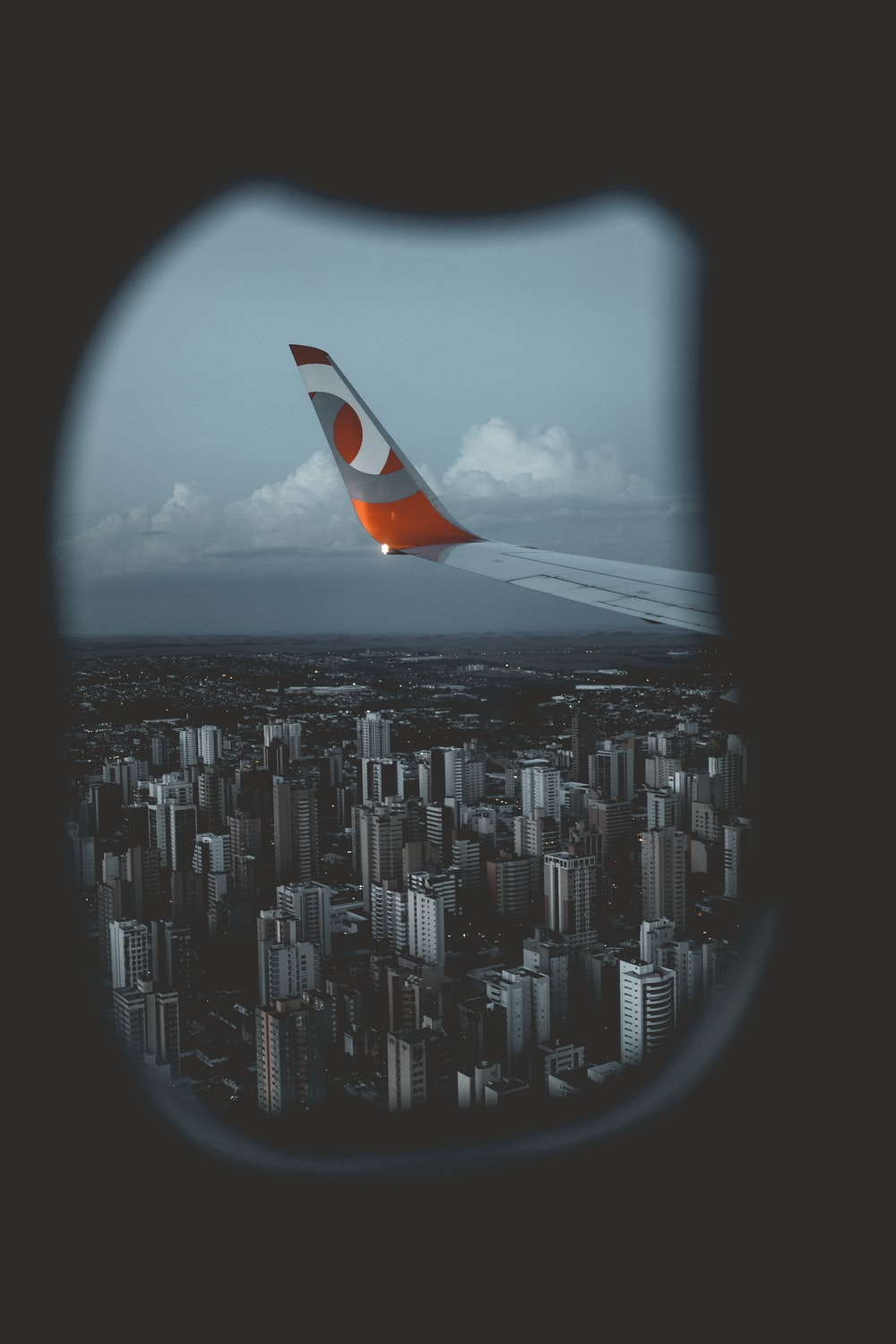 orange and gray plane winged flying on air during daytime