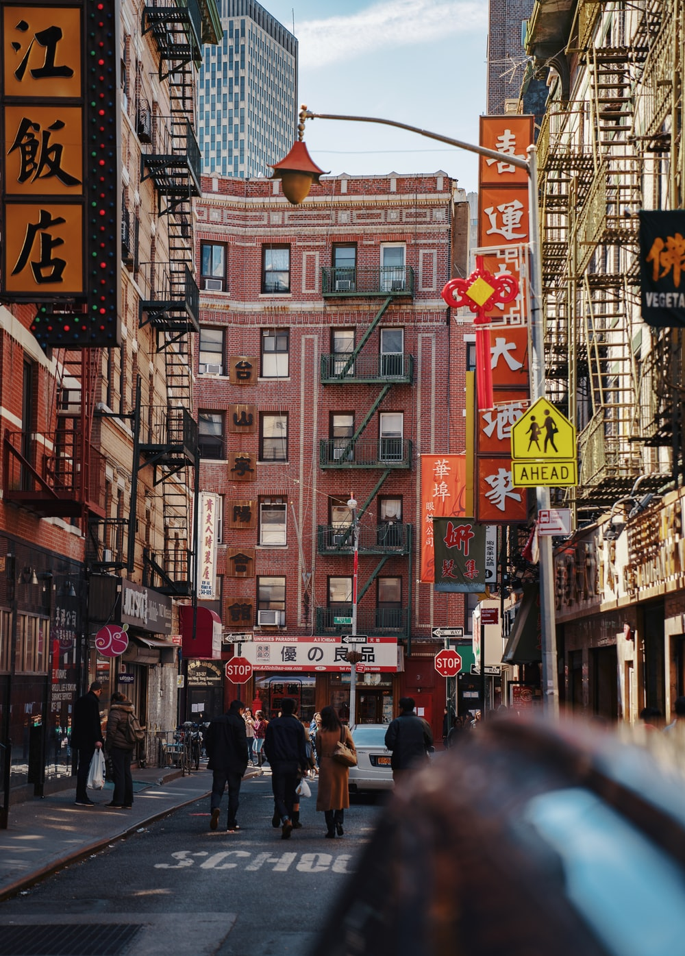 people walks on street during daytime