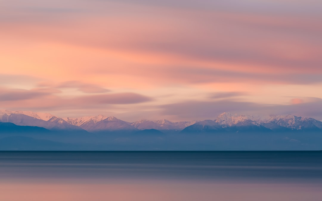 The Olympic Mountain range as seen from Deception Pass during sunrise in Washington.