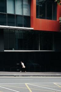woman talking beside building