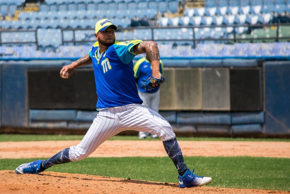 man pitching the baseball