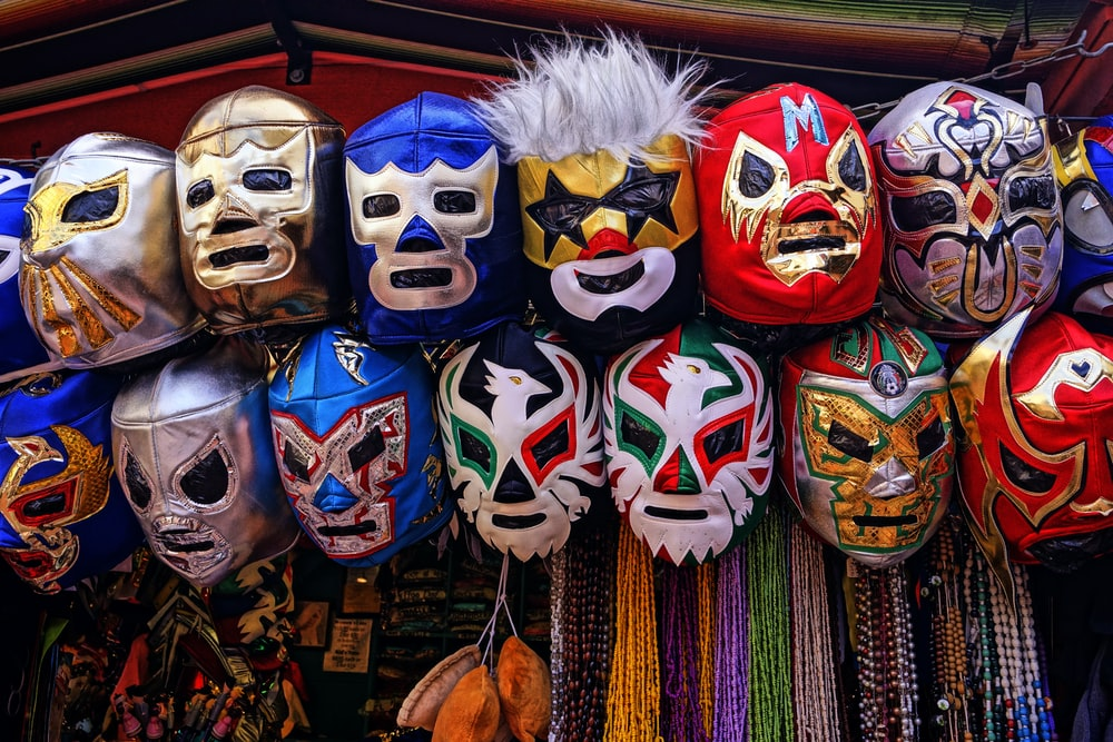 assorted-color of masks hanged on rod