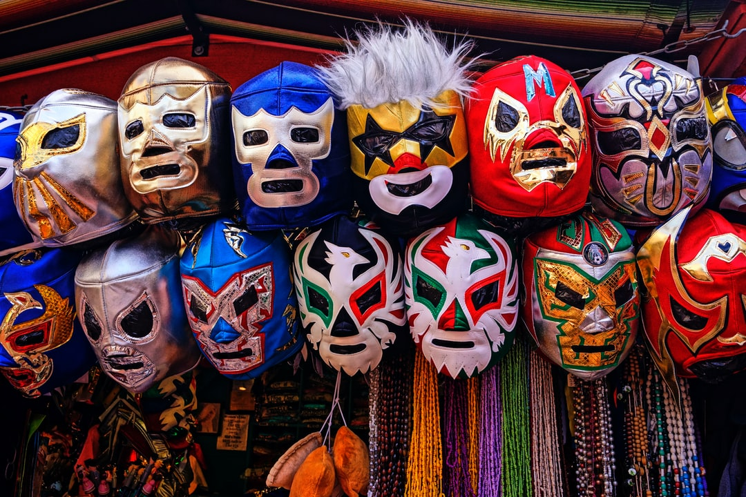 "Olvera Street, a historic monument in the oldest part of Los Angeles.  My wife is a librarian and had a big business meeting near Olvera street.  Since I had hours to kill as I waited for my wife I walked this famous and historic street.  I found these very colorful wresting masks displayed high up at one of the many vendor booths.  I think it would make a great background.  The title is a tribute to: Mil Máscaras (born Aaron Rodríguez Arellano, July 15, 1942) is a Mexican luchador.. Máscaras is one of the original ""Big Three"" of the lucha libre tradition in Mexico"