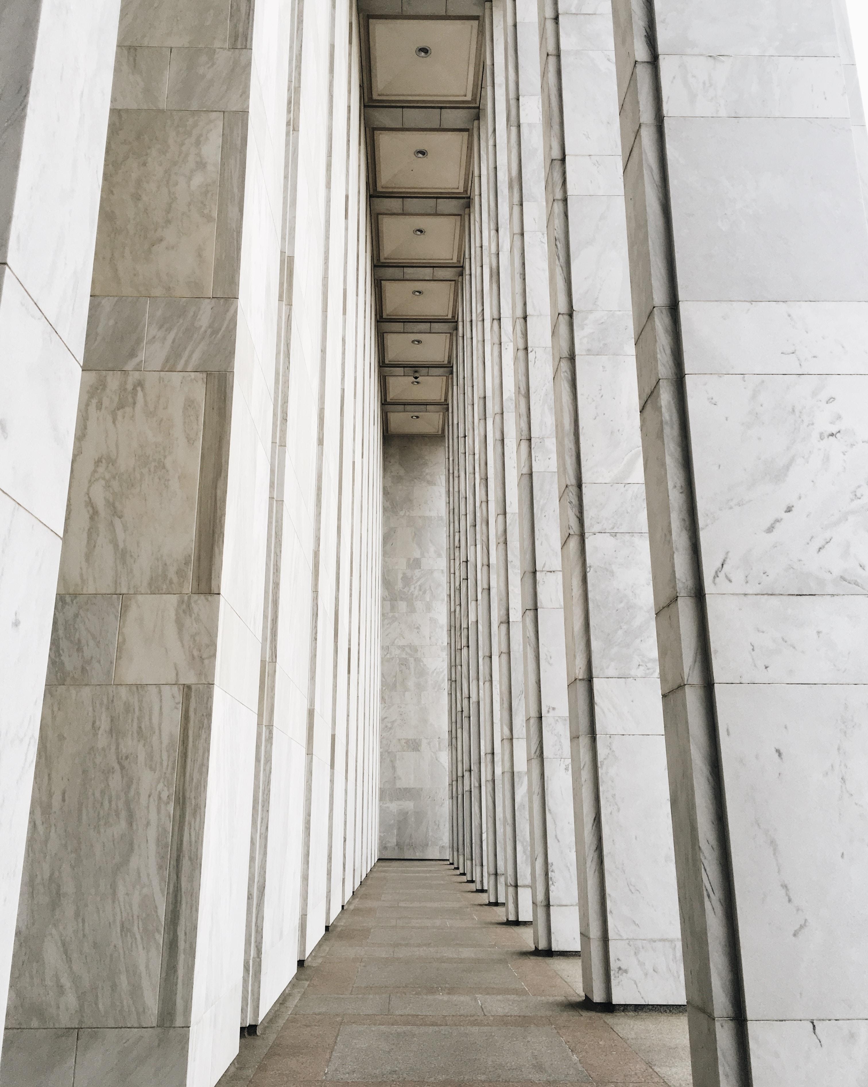 white concrete posts inside room