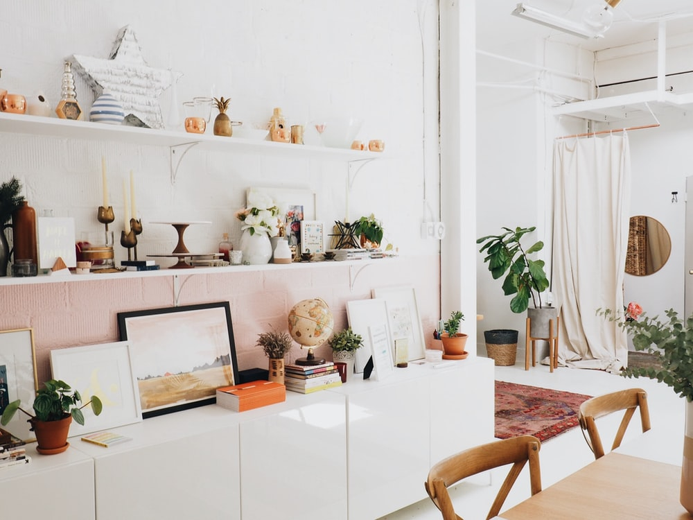 white wooden shelf and decors