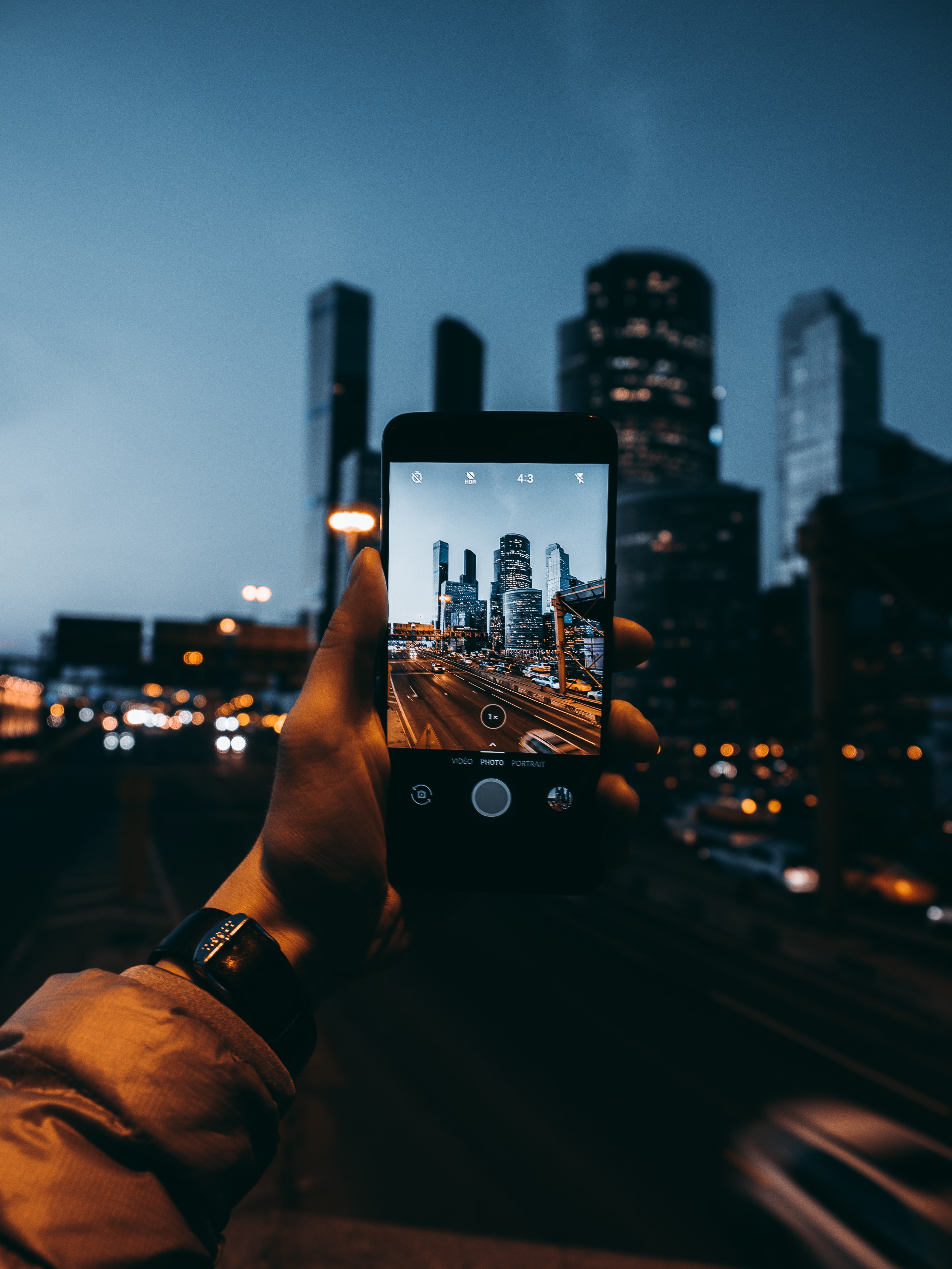 person taking photo of buildings