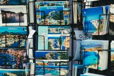 selective focus photography of landmarks card on rack