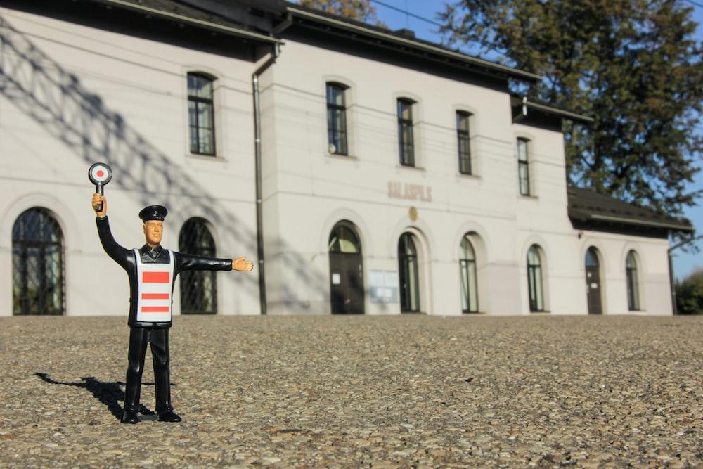 security figurine near on white building miniature