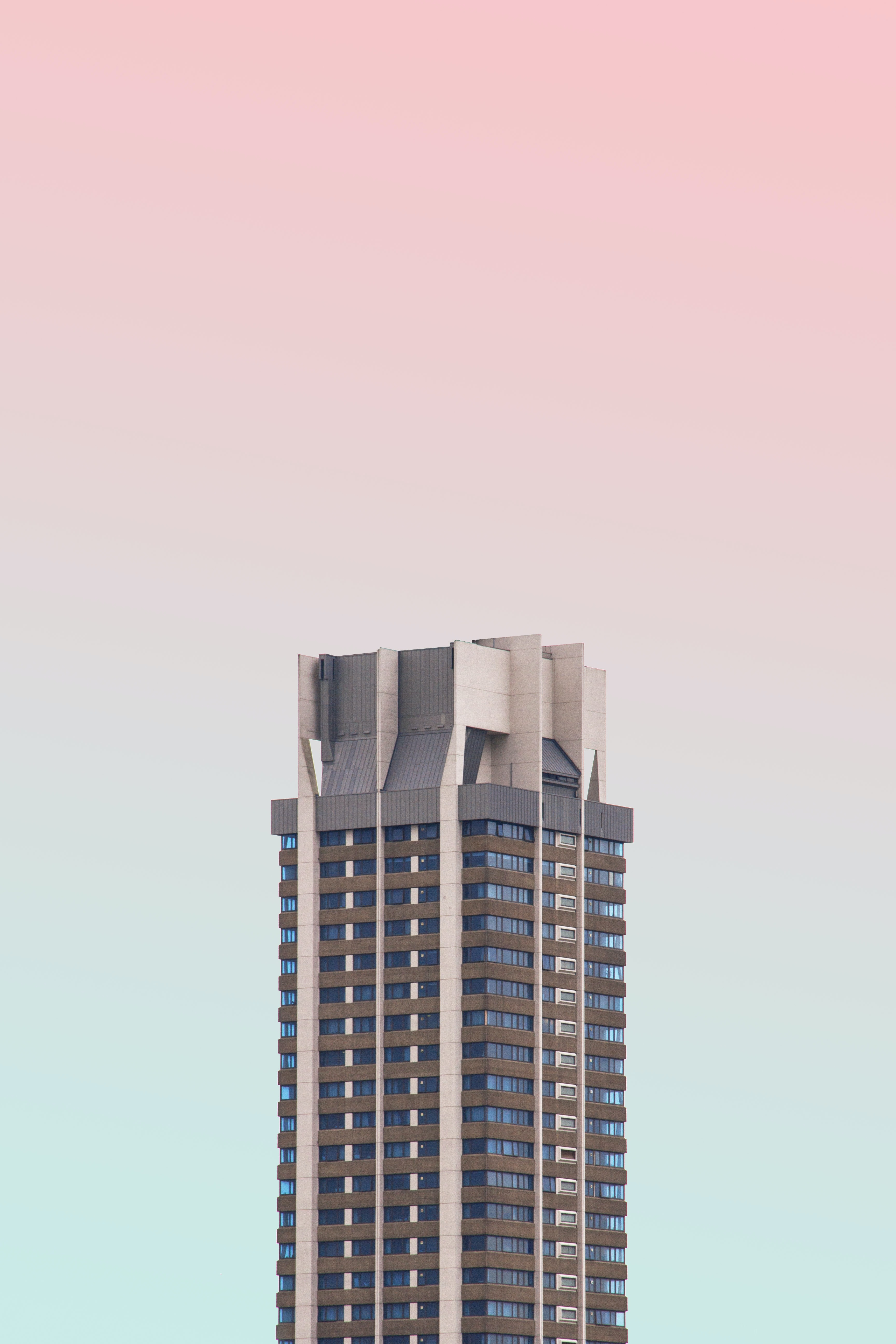 white and black high-rise building with glasses