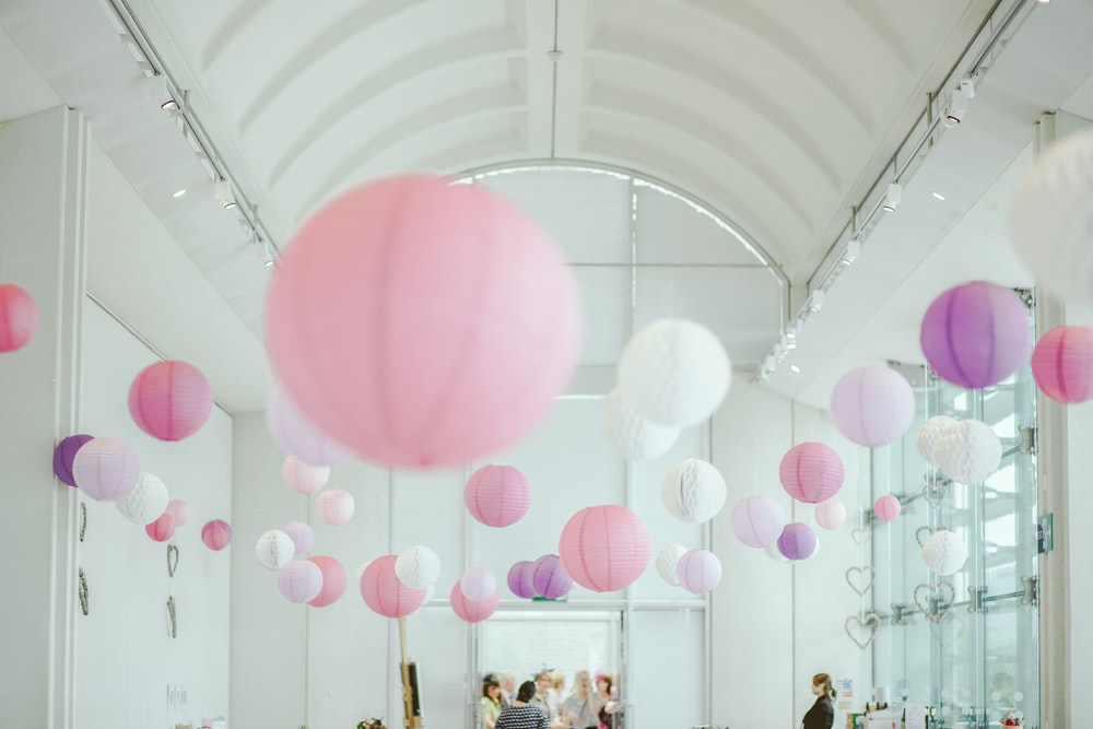 photo of pink, white and purple paper lanterns