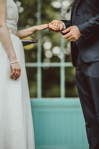 wedding couple holding hands together