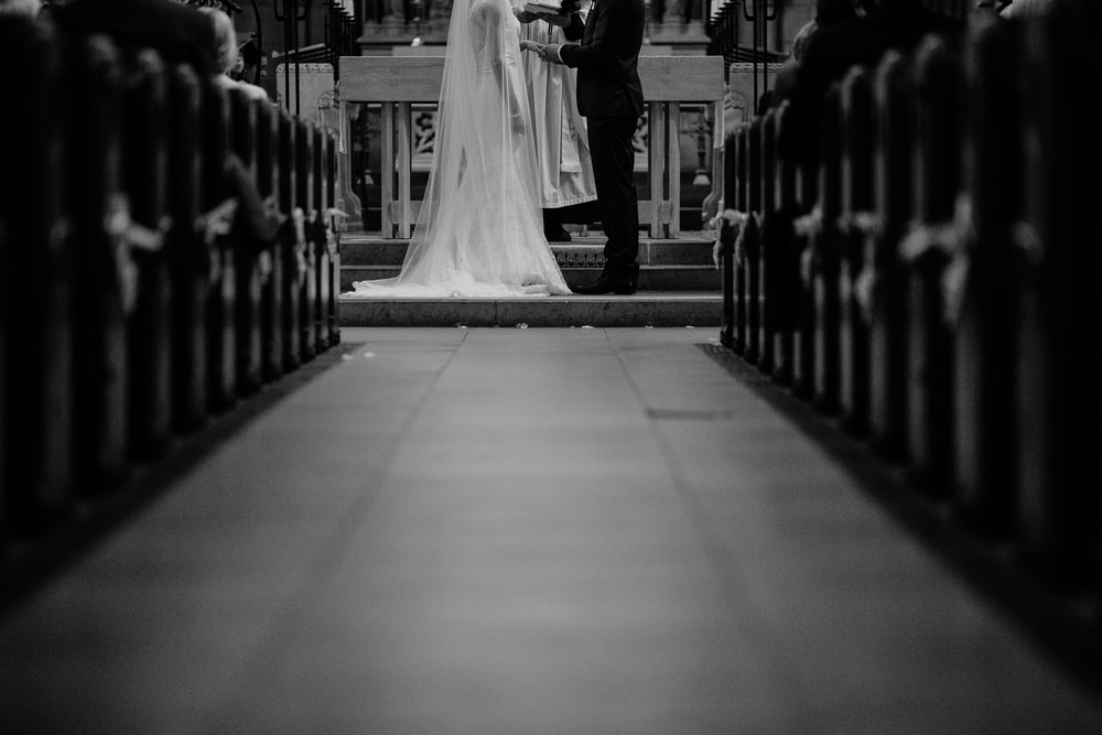 grayscale photo of groom and bride