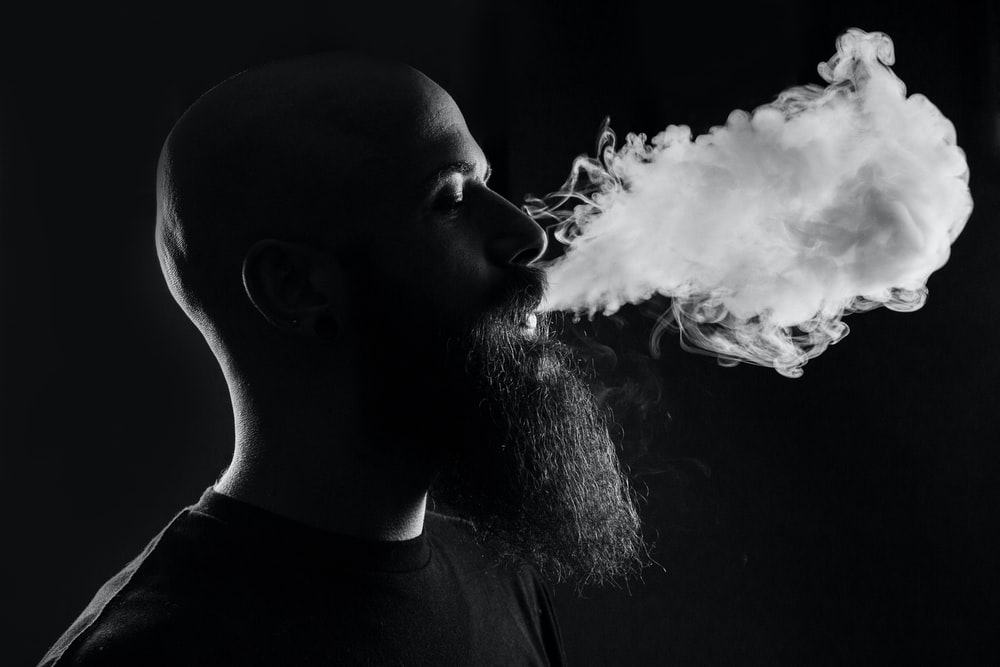 man smoking with black background