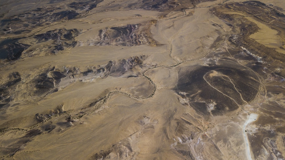 aerial photo of brown mountains during daytime