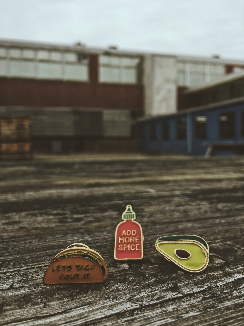 three taco, spice bottle and avocado ornaments on brown wood platform photo