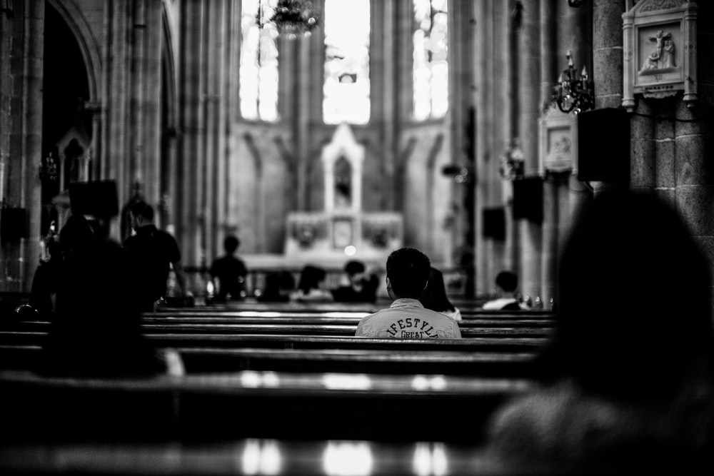 grayscale photo of wooden pew