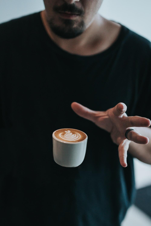 person catching white mug