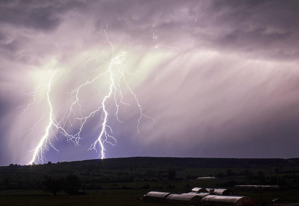 lightning storm during cloudy sky