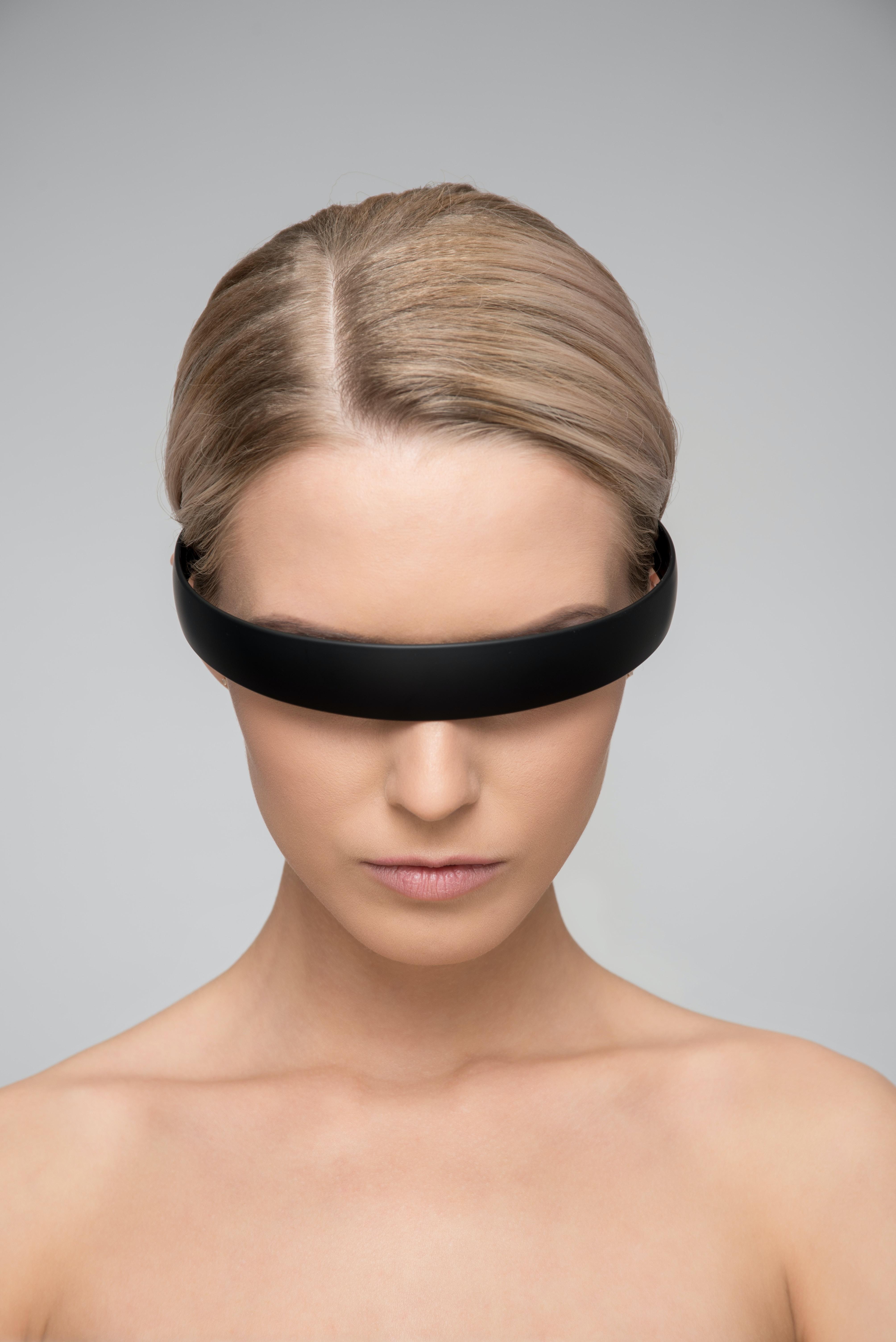 woman wearing black Alice band