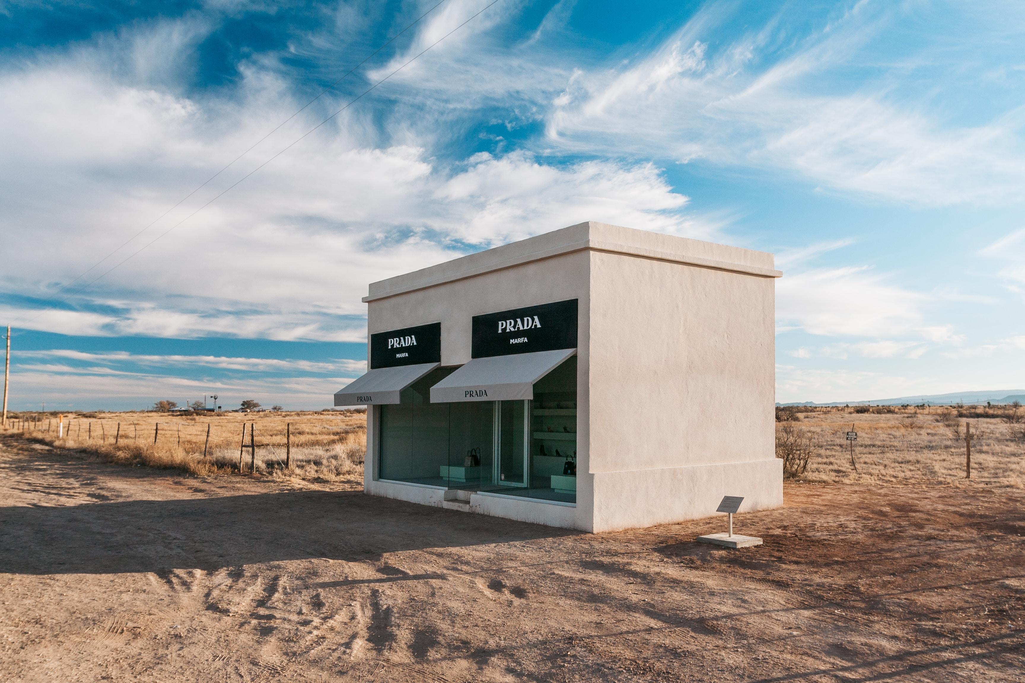 beige Prada concrete store in the middle of desert
