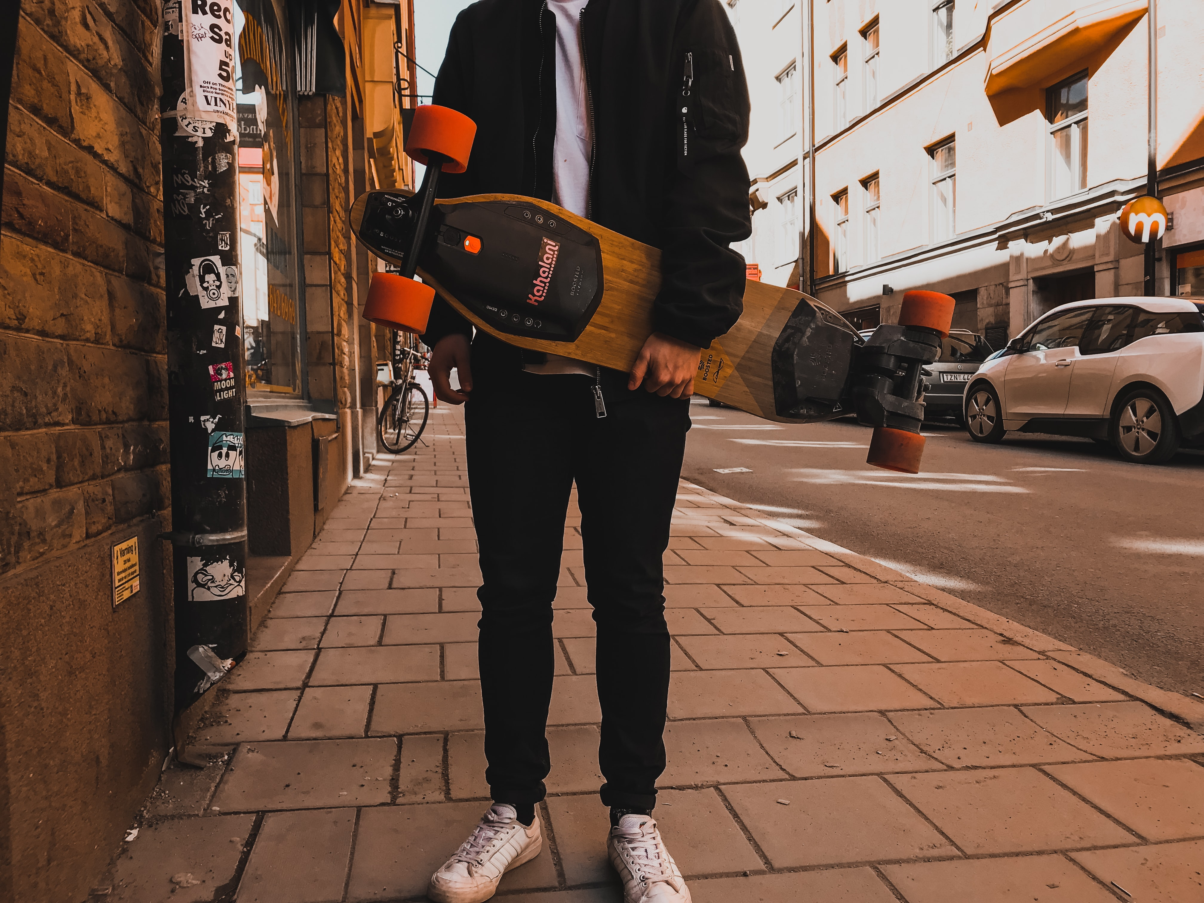 person holding skateboard near building