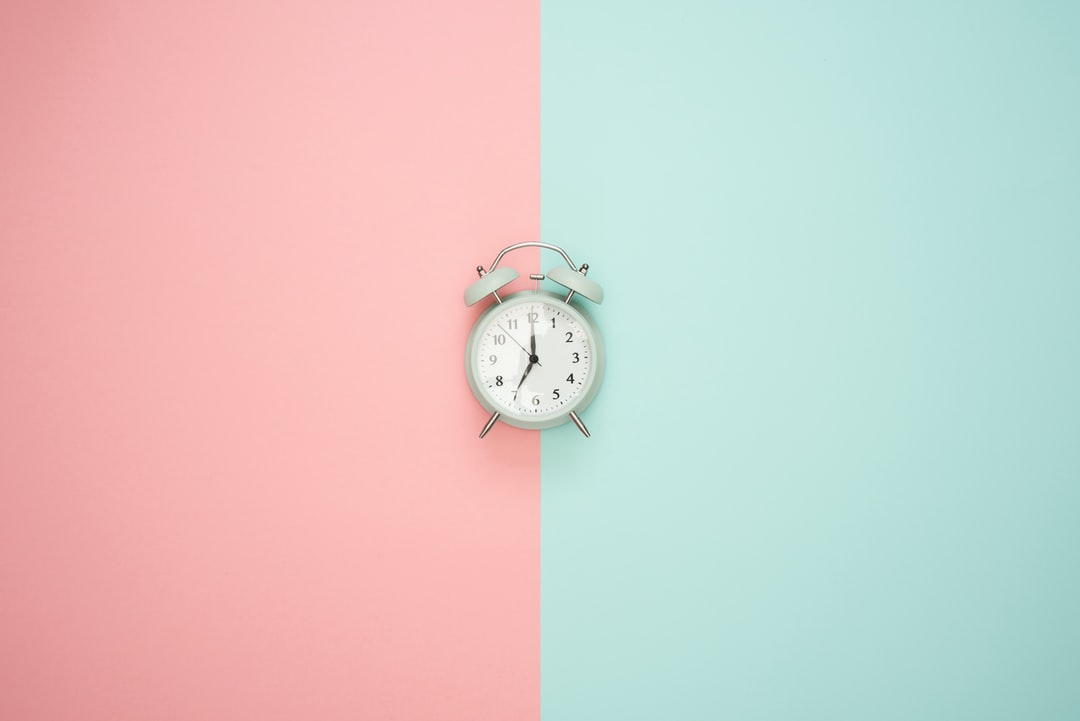 Blue clock on a pastel background