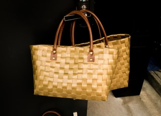 two brown woven tote bags