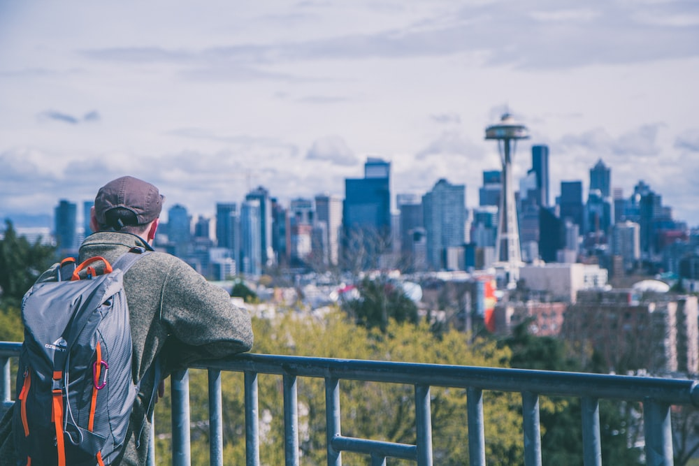 man overlooking space needle