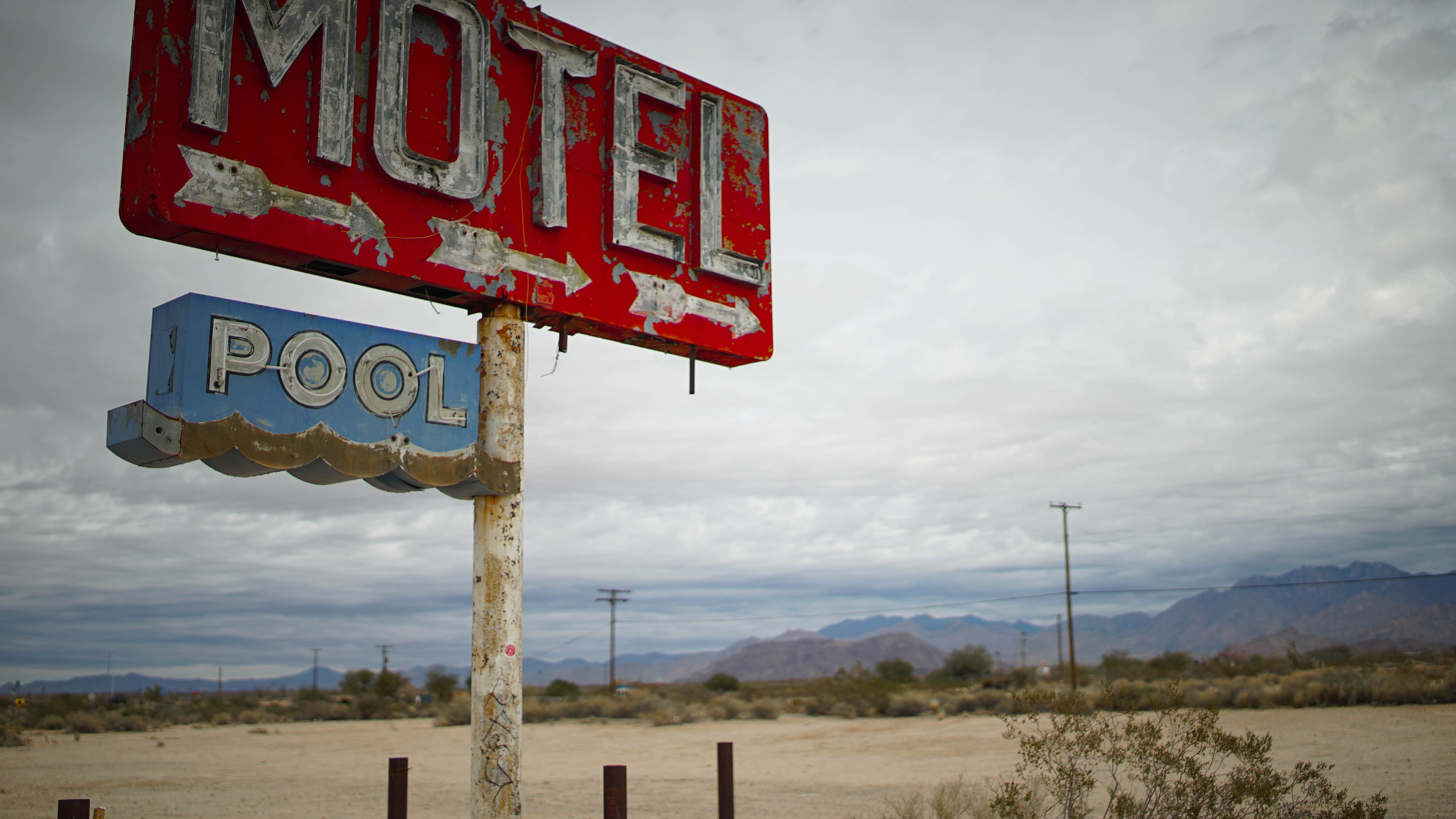 red motel signage in shallow focus