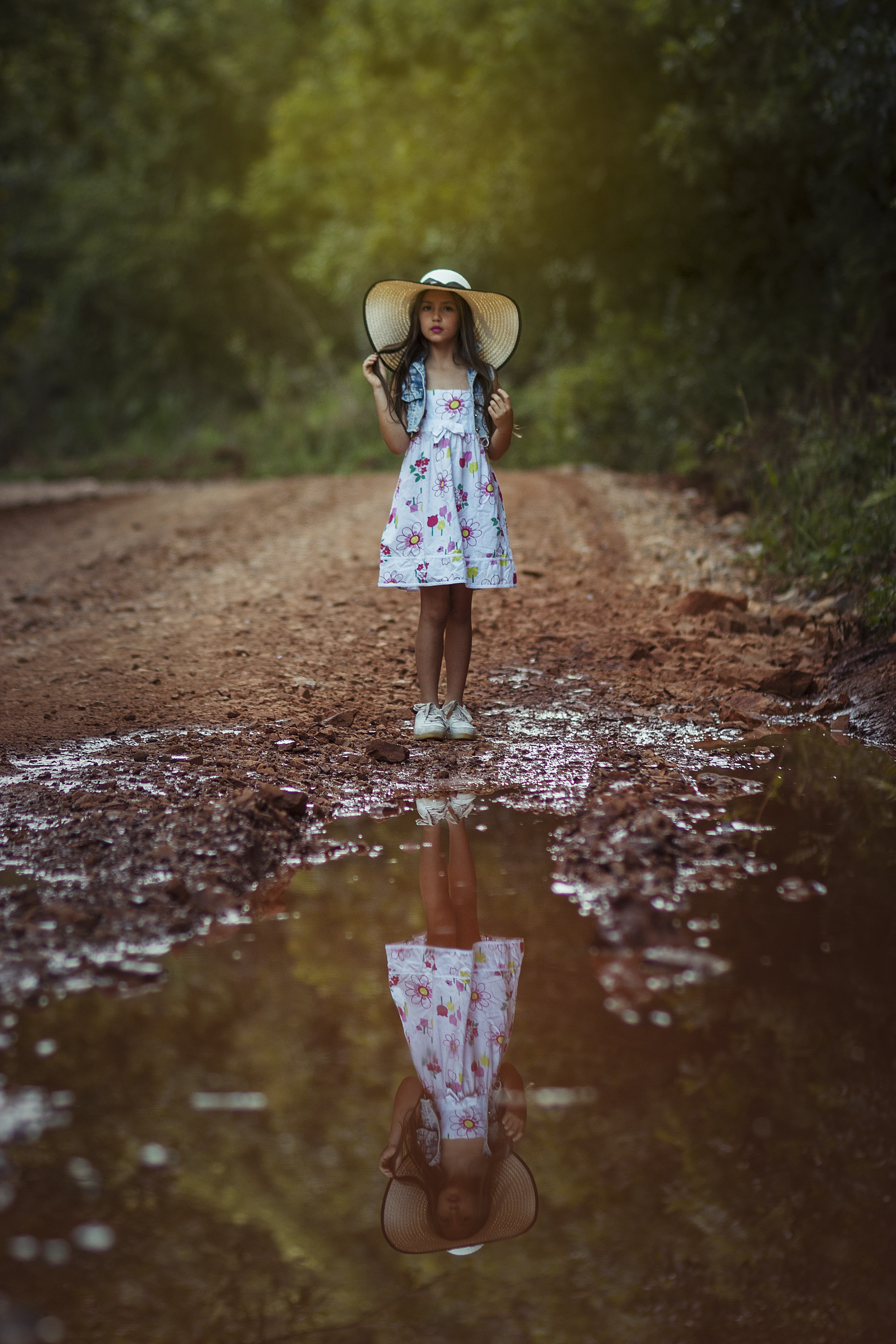 girl standing in front body of water