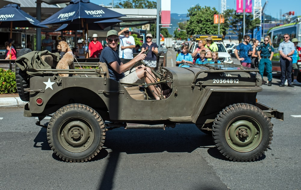 man driving a military jeep