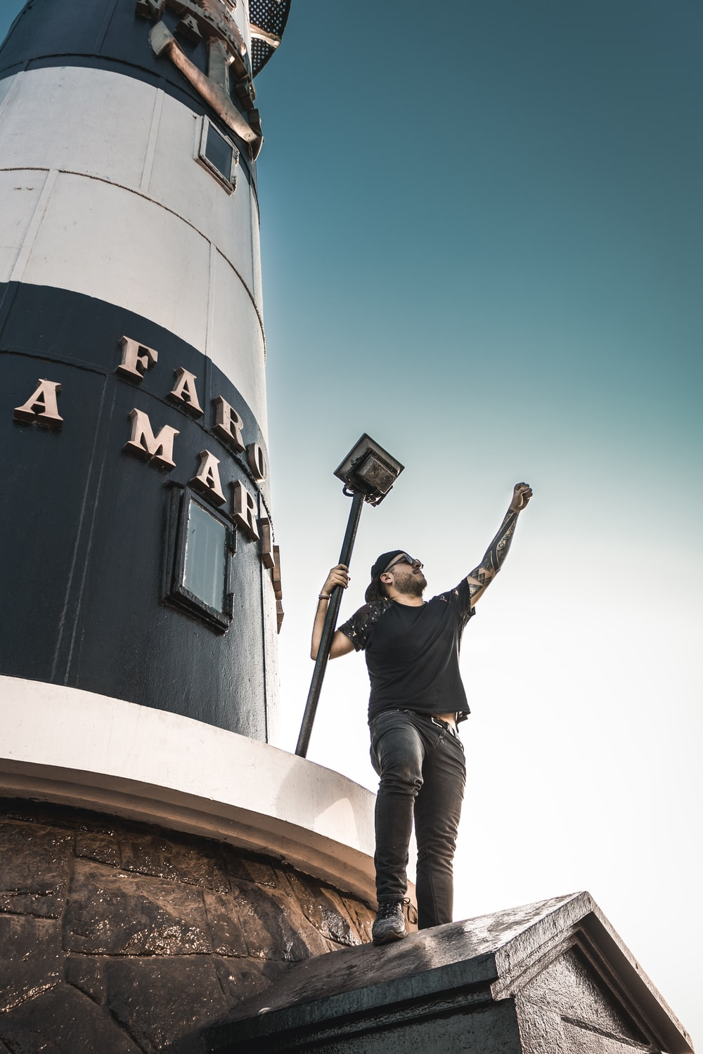man taking selfie on lighthouse