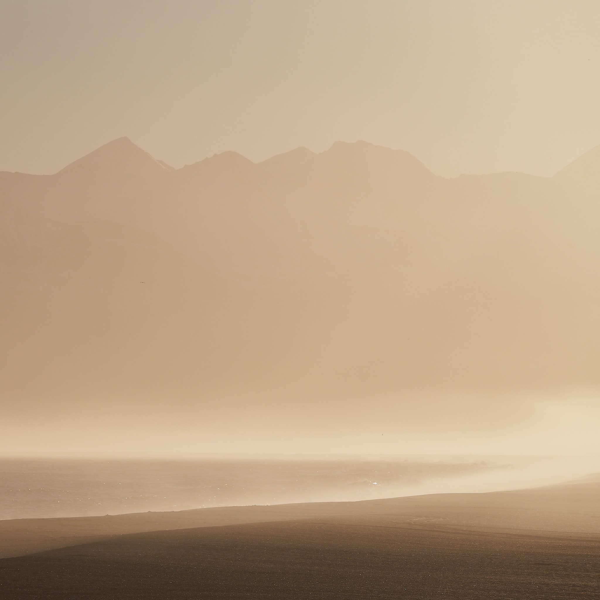 silhouette of foggy mountain range