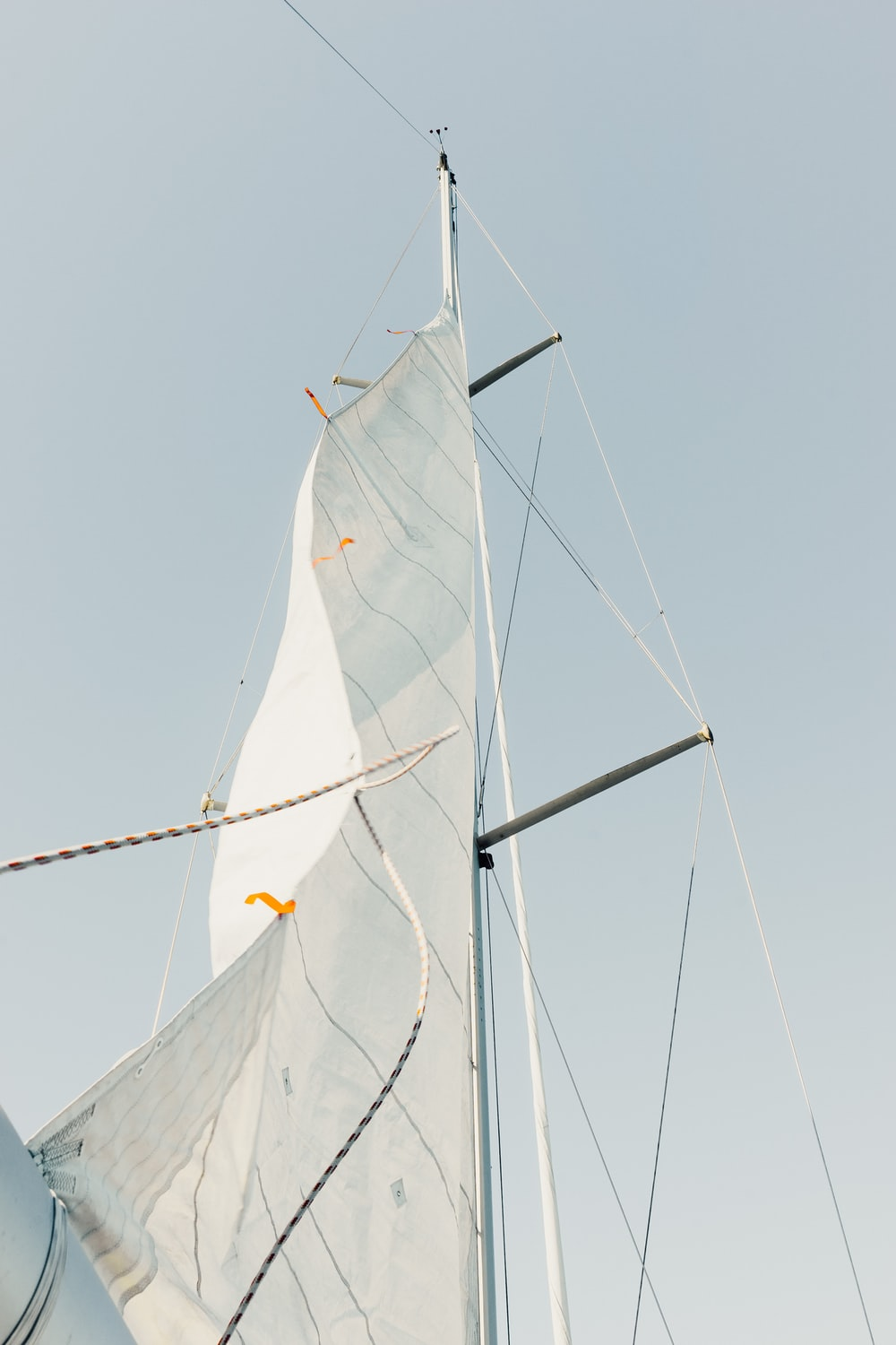 low angle photo of white sail