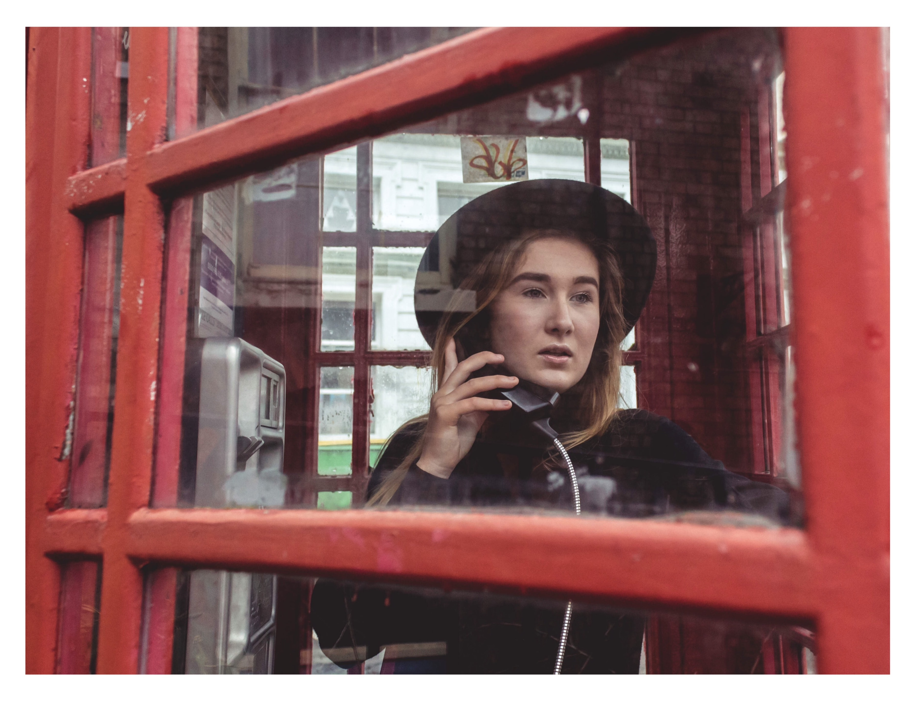 woman taking on the phone