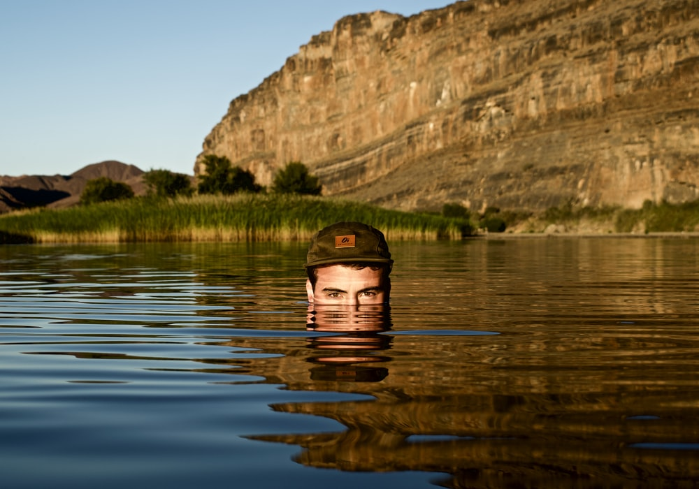 man in body of water facing on camera