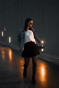 woman walking through concrete road