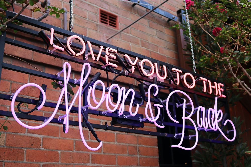 Love You To The Moon & Back neon signage photo