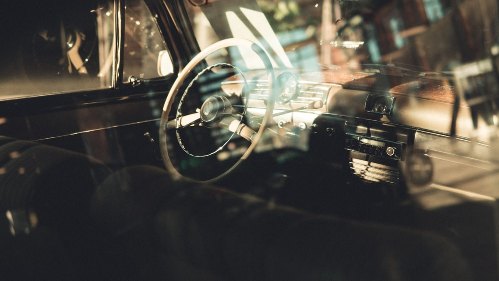 photo of black car steering wheel